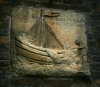 Stone carved sign of sailing boat