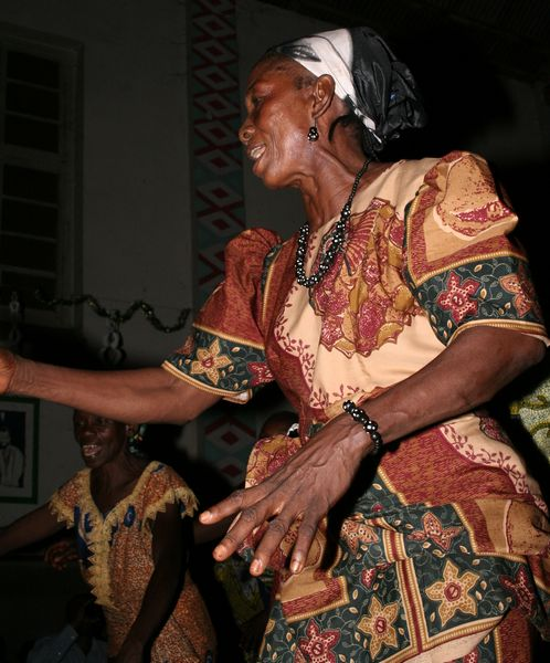 Old woman dancing on traditional wedding