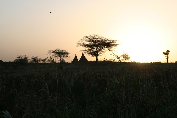 Sunset over a couple of traditional dwellings in Meki, in the Ethiopian Rift Valley
