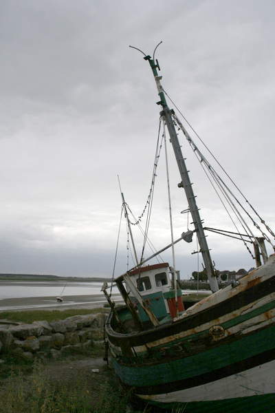 Derelict fishing boats at the end of the harbour of Le Crotoy
