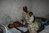 Mother with children in medical centre in Congo