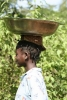 Girl carrying a pan on her head